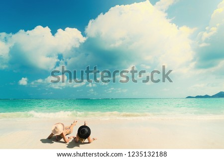 Woman suntanning - Winter holidays at the tropical beach #1235132188
