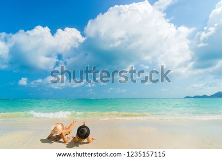 Woman suntanning - Winter holidays at the tropical beach #1235157115