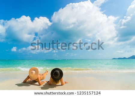 Woman suntanning - Winter holidays at the tropical beach #1235157124