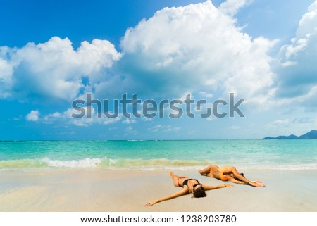 Woman suntanning - Winter holidays at the tropical beach #1238203780