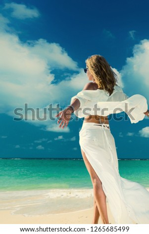 Woman suntanning - Winter holidays at the tropical beach #1265685499