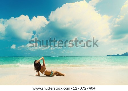 Woman suntanning - Winter holidays at the tropical beach #1270727404