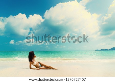 Woman suntanning - Winter holidays at the tropical beach #1270727407