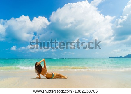 Woman suntanning - Winter holidays at the tropical beach #1382138705