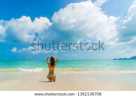 Woman suntanning - Winter holidays at the tropical beach #1382138708