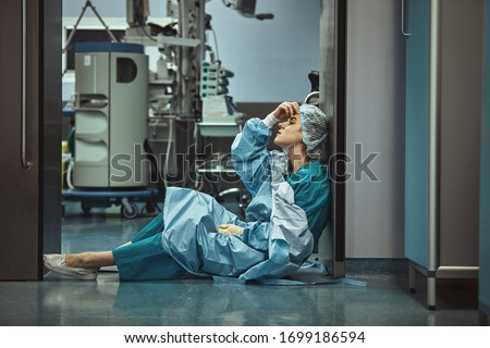 Woman surgeon looking sadness fatigue after surgery copyspace stress depression guilt unhappy problem worker medicine healthcare emotions
