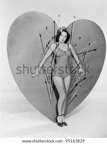 Woman surrounded by arrows on huge heart