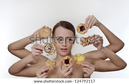 woman surrounded by many hands holding cream cakes with so much choice and temptation is she going to forget about her diet and indulge herself