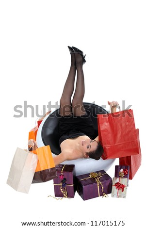 Woman surrounded by presents and bags