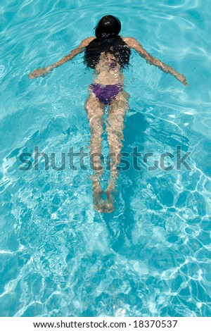 woman swimming at the pool
