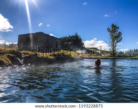 Woman swimming in natural thermal pool in fludir secret lagoon #1193228875