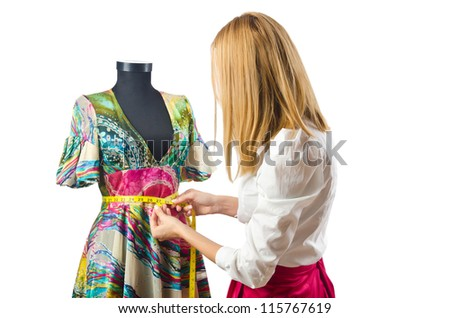 Woman tailor working on dress