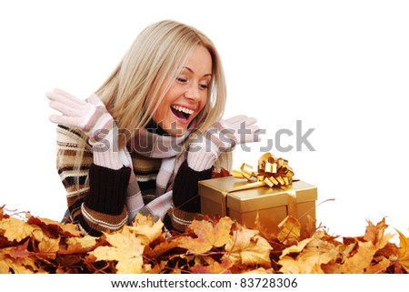woman take autumn gift isolated in studio