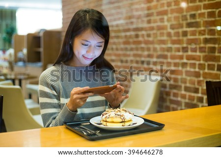 Woman take photo on her food