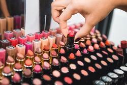 Woman takes a lipstick.