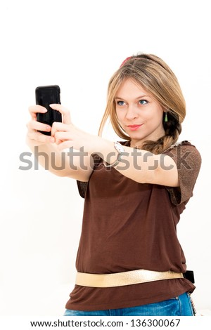 woman takes a picture with a phone on white background
