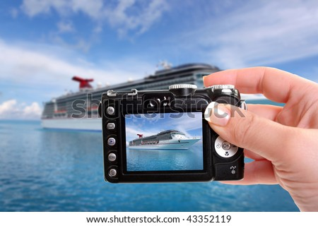 Woman takes snapshot picture of cruise ship in the clear blue Caribbean ocean