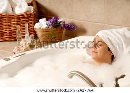 woman taking a aroma bath at a day spa