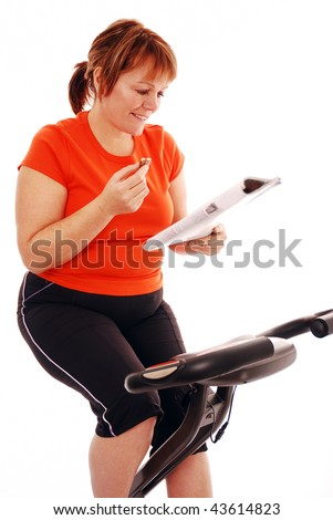 Woman taking a break while on exercise bike over white