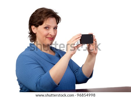 Woman taking a flash picture with her smart phone - stock photo
