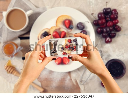 Woman taking a photo of breakfast with smartphone #227516047