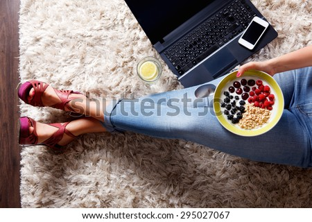 Woman taking a selfie of her healthy snack