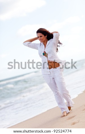 Woman taking a walk at the beach and relaxing