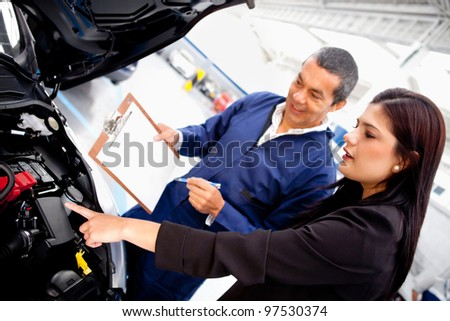Woman taking car to the garage for mechanical checkup