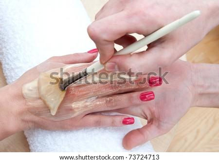 woman taking hand skin beauty treatment