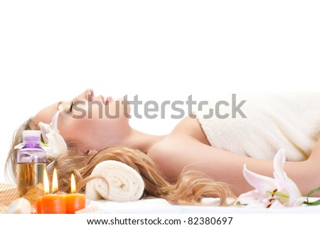 woman taking over spa treatment over white