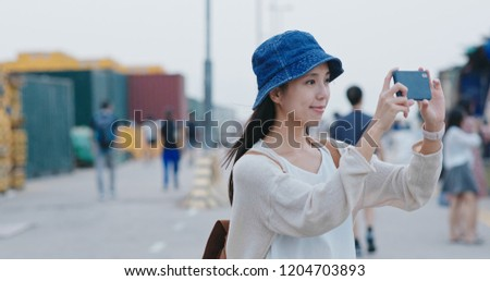 Woman taking photo on the sunset