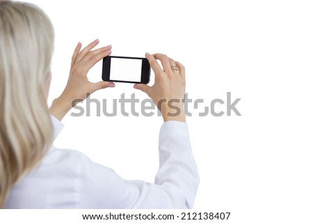 Woman taking photo with mobile phone. Isolated white background for your own image.