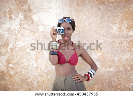 Woman taking pictures with a retro camera
