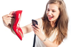 Woman taking pictures with red shoes using her smartphone