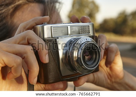 woman taking pictures with...