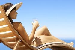 woman taking sunbath near swimming pool and beach