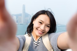 Woman taking the selfie in Hong Kong