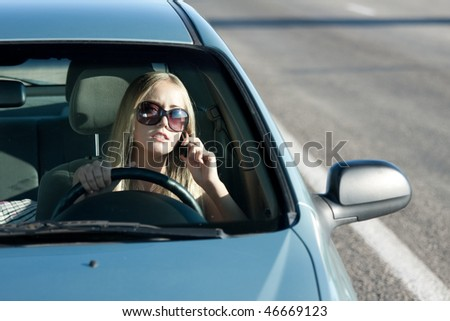 Woman talking in the car by mobile