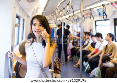 Woman talking on cellphone inside train compartment #591329195