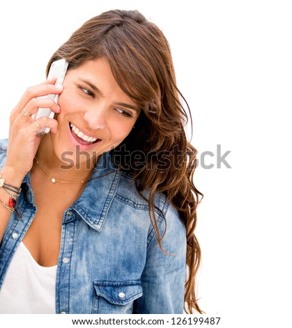 Woman talking on her cell phone - isolated over a white background
