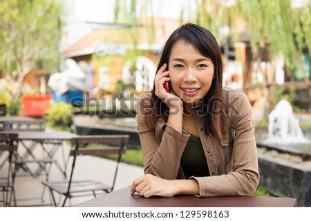 Woman talking on mobile phone at outdoor