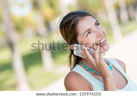 Woman talking on the phone looking very happy - stock photo