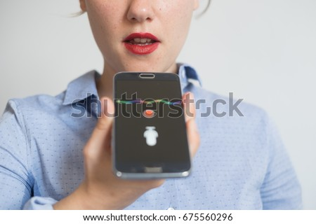 Woman talking on the phone with the digital voice assistant