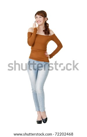 Woman talking with cellphone and smiling, full length portrait isolated on white background.