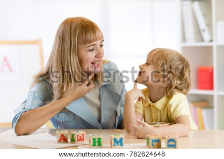 Woman teacher and kid boy on private lesson.