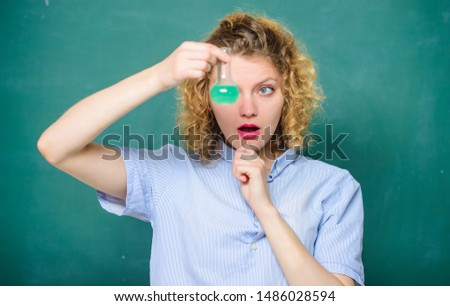 Woman teacher performing experiment with bulb and liquid. Girl observing chemical reaction chalkboard background. Explore chemistry. Chemistry lesson. Chemistry lab. Interesting and fascinating.