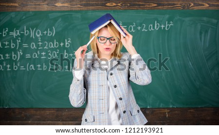 Woman teacher with book as roof on head. Memorizing method. Train memory every day. Effective method to remember information. Cognitive process concept. Keep in memory. Improve memory skill.