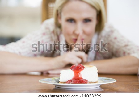 Woman Tempted By Slice Of Strawberry Cheesecake