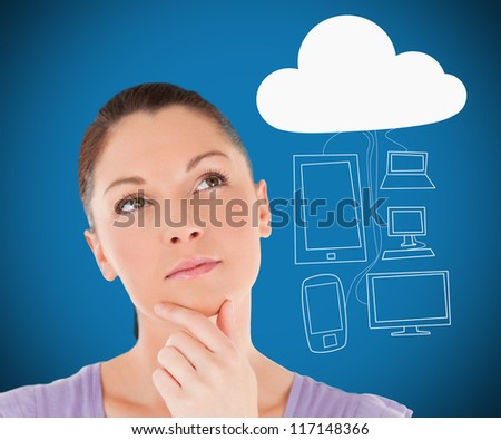 Woman thinking about media devices connecting through cloud computing on blue background