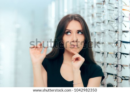 Woman Thinking to Choose Contact Lenses Over Eyeglasses. Girl considering the advantages and disadvantages of wearing contacts